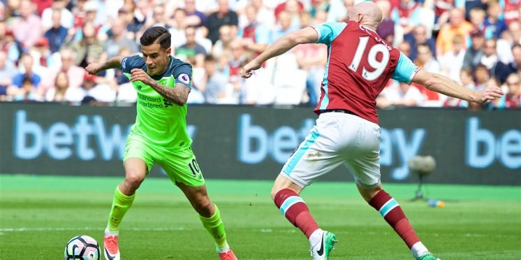 Liverpool playmaker Philippe Coutinho (left) and West Ham defender James Collins